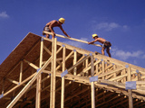 Construction Workers Framing a House Photographic Print by Bill Bachmann