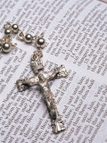 Silver Crucifix Lying on Open Bible Photographic Print by David Davis