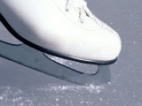 Close-up of Figure Skate on Ice Photographic Print by Ken Wardius