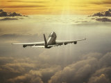Airplane Flying in Sky Photographic Print by Peter Walton