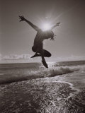 Silhouette of Dancer Jumping Over Atlantic Ocean Fotoprint van Robin Hill