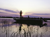 Man Standing in Boat Fishing Photographic Print by Timothy O'Keefe