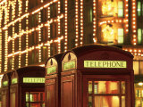 Telephone Booths in Front Store, London, England Photographic Print by Walter Bibikow