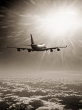 Airplane Flying Through Clouds Photographic Print by Peter Walton