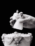 Female hand holding wedding cake topper Lmina fotogrfica por Howard Sokol