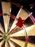 Dart in Bull&#39;s Eye of Dart Board Photographic Print by Greg Smith