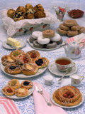 Table Set with Tea and Various Pastries Photographic Print by Katie Deits