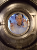Man with Tool in Washing Machine Photographic Print by John Burke