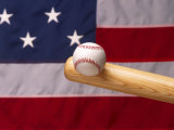 Bat Hitting Baseball Against Flag Photographic Print by Tomas del Amo