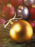 Gold Christmas Ornament with White Ribbon Photographic Print by Ellen Kamp