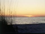 Soleil couchant sur l'île de Sanibel, côte du Golfe de Floride Photographie par David Davis