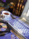 Laptop Computer, Cd-Rom, Cup of Tea, and Books Photographic Print by Ellen Kamp