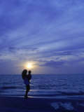 Silhouette of Mother and Child on Beach at Sunset Photographic Print by Greg Smith