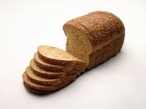Sliced Loaf of Bread Photographic Print by Howard Sokol