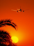 Airplane Flying Over Sunrise Photographic Print by Peter Walton