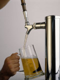 Tap Pouring Beer Into Mug Photographic Print by William Swartz