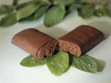 Chocolate Nutrition Bar on Mint Leaves Photographic Print by Chris Rogers