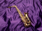 Saxophone on Purple Background Photographic Print by Howard Sokol