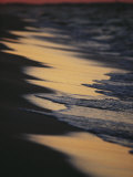 Surf Gently Lapping on a Sandy Beach at Twilight Photographic Print by Raymond Gehman
