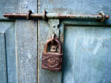 Close View of an Old Padlock Photographic Print by Paul Chesley