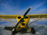 A Small Personal Aircraft Sitting in a Snowy Field Photographic Print by Heather Perry