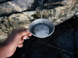 Hiker Getting a Cool Cup of Water Photographic Print by Sam Abell