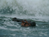 A Hippopotamus (Hippopotamus Amphibius) in the Surf Photographic Print by Michael Nichols