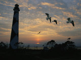 Cape Lookout Lighthouse Silhouetted against the Sky Photographic Print by Stephen Alvarez