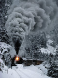 A Train Chugs Through the Snow Blanketing the San Juan Mountains Fotografie-Druck von Paul Chesley