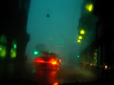 Misty View of Car Lights on a City Street During a Rain Storm Photographic Print by Sisse Brimberg