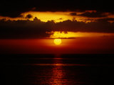 Sunset at Anilao Photographic Print by Wolcott Henry