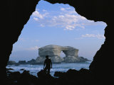 A Man Silhouetted against La Portada Rock Arch on the Coast of Chile Photographic Print by Joel Sartore