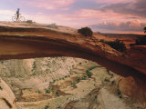 Mountain-Biking over a Natural Arch Photographic Print by Kate Thompson