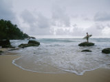 A Man Stands with a Surfboard on a Beach in the Dominican Republic Photographic Print by Stephen Alvarez