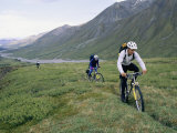 Bikers Travel Across the Rough Terrain and Melt Ice of the Alaska Range Photographic Print by Bill Hatcher