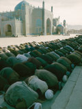 Afghan Men Pray Near the Mosque in Mazar-I-Sharif Photographic Print by Thomas J. Abercrombie