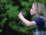 A Young Girl Plays Out a Fairy Tale as She Prepares to Kiss a Frog Photographic Print by Joel Sartore