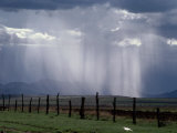Veils of Rain Stream from Sunlit Clouds over Farmland Photographic Print by George Grall