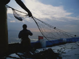 Fishermen Haul in a Net and Remove Fish from It Photographic Print by Jodi Cobb