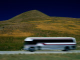 Panned View of a Bus on Interstate 15 Photographic Print by Raymond Gehman