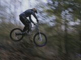 A Boy Flies Through the Air on His Mountain Bike Photographic Print by Roy Gumpel