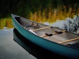 Canoe and Reflections on a Still Lake Photographic Print by Raymond Gehman
