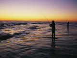 People are Surf Fishing for Red Drum on the Outer Banks of North Carolina Photographic Print by Stephen Alvarez