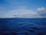A Rainbow Rises over the Waters Surface in Twofold Bay Photographic Print by Jason Edwards