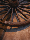 Close-up of Wooden Wagon Wheel Lit by Setting Sun Photographic Print by Todd Gipstein