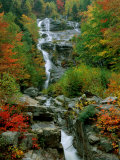 A Stream Runs Swiftly over Rocks Fotoprint van Medford Taylor