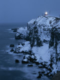 A Lighthouse Atop Snow-Covered Cliffs on Notsuke Bay Photographic Print by Tim Laman