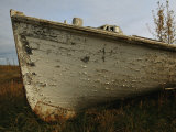 A Wooden Boat Lies Abandoned at the Hay River Shipyard Photographic Print by Raymond Gehman