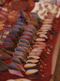 Tiny Lotus Shoes for Women with Bound Feet Fill a Stall Photographic Print by Jodi Cobb