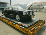 Luxury Bentley Unloaded from an Airplane at Chek Lap Kok Airport Photographic Print by  xPacifica